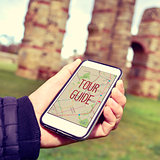 man with a smartphone with the text tour guide