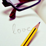 eyeglasses and word love in a notebook