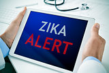 doctor with a tablet with the text zika alert