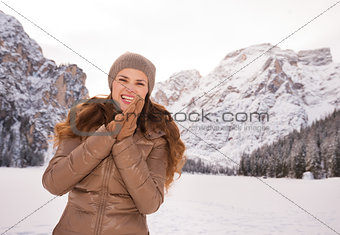 Portrait of smiling woman outdoors among snow-capped mountains