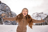 Woman rejoicing outdoors among snow-capped mountains
