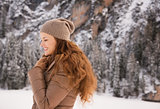Portrait of happy woman outdoors among snow-capped mountains