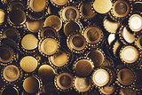 Beer bottle caps heap as background