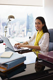 Business Woman Assistant Smiles At Camera Typing On PC