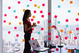 Secretary Organizing Tasks Writing Sticky Notes On Window