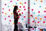 Secretary Organizing Tasks Writing Sticky Notes On Window