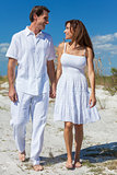 Middle Aged Couple Walking on An Empty Beach