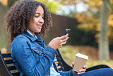 African American Teenager Woman Drinking Coffee and Texting