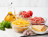 Italian food ingredients: pasta, tomatoes, herbs, minced