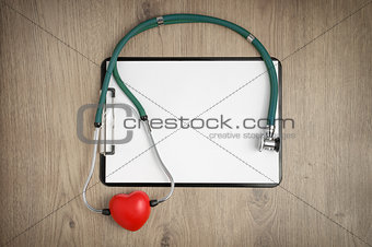 Clipboard with stethoscope and heart shape