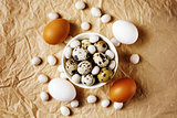 Food background with different eggs on craft paper
