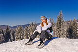 Girl sitting on ski slope