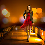 Woman in Red Dress Walking. Night City