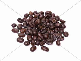 Small pile of roasted coffee beans isolated on white background