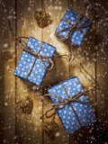 Gift boxes in blue paper on the wooden table