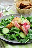 fresh healthy salad with radish, cucumber and arugula