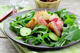fresh healthy salad with radish, cucumber and arugula