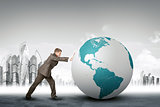 Businessman pushing earth globe