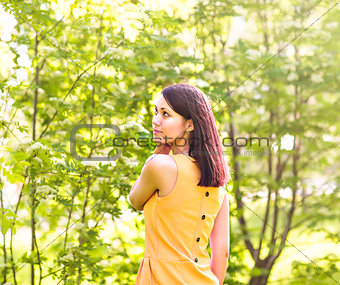 Portrait of young beautiful woman in spring blossom trees