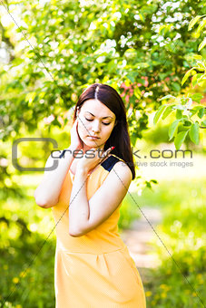 Portrait of young asian woman in spring blossom trees