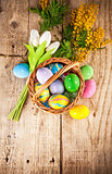 Easter eggs in wicker basket with copyspace