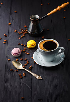 Cup coffee with grain and cezve