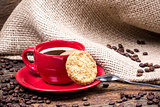 Coffee cup with biscuit spoon and coffeebeans