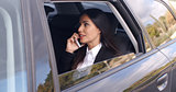 Beautiful business woman on phone in automobile