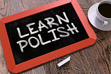 Hand Drawn Learn Polish Concept on Chalkboard.