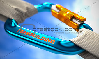 Blue Carabiner Hook with Text Teambuilding.