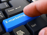 E-Marketing - Concept on Blue Keyboard Button.