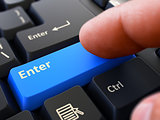 Finger Presses Blue Keyboard Button Enter.