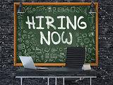 Hiring Now on Chalkboard in the Office.