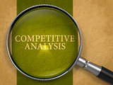 Competitive Analysis through Loupe on Old Paper.