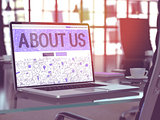 Laptop Screen with About Us Concept.
