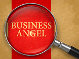 Business Angel through Loupe on Old Paper.
