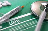 COPD. Medical Concept on Green Background.
