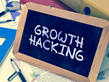 Handwritten Growth Hacking on a Chalkboard.
