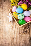 Easter still life with basket eggs rabbit