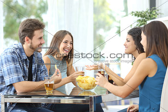 Group of friends talking at home