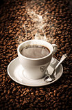 Hot coffee with beans background
