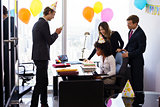Business People Celebrating Colleague Birthday Party In Office