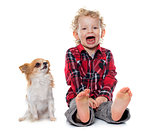 little boy and chihuahua crying