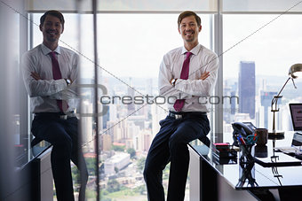 Portrait Of White Collar Worker Smiling At Camera In Office