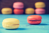 macarons on a blue rustic surface