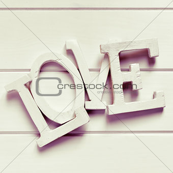 three-dimensional letters forming the word love, filtered