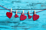 red hearts hanging in a clothes line