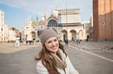 Portrait of happy young woman standing on Piazza San Marco