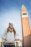Woman standing in front of bell tower of St Mark's Basilica