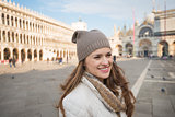 Happy young woman on Piazza San Marco having fun time